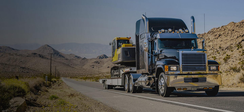 black Mack Truck driving on highway